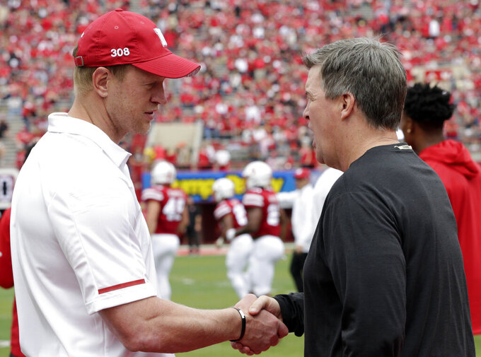 Nebraska head coach Scott Frost, left, and Colorado head coach Sandy Macintyre shake hands before an NCAA college football game in Lincoln, Neb., Saturday, Sept. 8, 2018. (AP Photo/Nati Harnik)