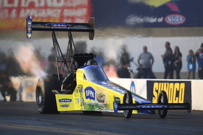 In this photo provided by the NHRA, Brittany Force drives in Top Fuel qualifying at the Mopar Express Lane NHRA Nationals drag races Friday, Sept. 10, 2021, at Maple Grove Raceway in Mohnton, Pa. (Marc Gewertz/NHRA via AP)