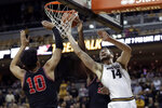 Missouri's Reed Nikko (14) heads to the basket as Georgia's Toumani Camara (10) defends during the second half of an NCAA college basketball game Tuesday, Jan. 28, 2020, in Columbia, Mo. Missouri won 72-69. (AP Photo/Jeff Roberson)