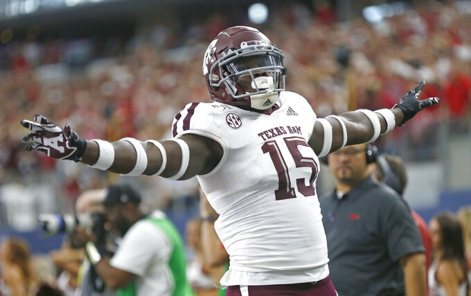 Texas A&M defensive lineman Jeremiah Martin (15) celebrates after Arkansas failed to convert on fourth down during the second half of an NCAA college football game Saturday, Sept. 28, 2019, in Arlington, Texas. Texas A&M won 31-27. (AP Photo/Ron Jenkins)