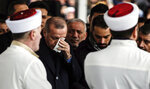 Turkey's President Recep Tayyip Erdogan, center, reacts as he joins hundreds of mourners who attend the funeral prayers for nine members of Alemdar family killed in a collapsed apartment building, in Istanbul, Saturday, Feb. 9, 2019. Erdogan says there are