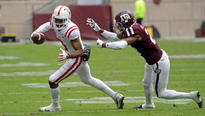 Mississippi Rebels wide receiver DaMarkus Lodge (5) breaks away from Texas A&M defensive back Charles Oliver (21) to score a touchdown after catching a pass during the first half of an NCAA college football game Saturday, Nov. 10, 2018, in College Station, Texas. (AP Photo/David J. Phillip)