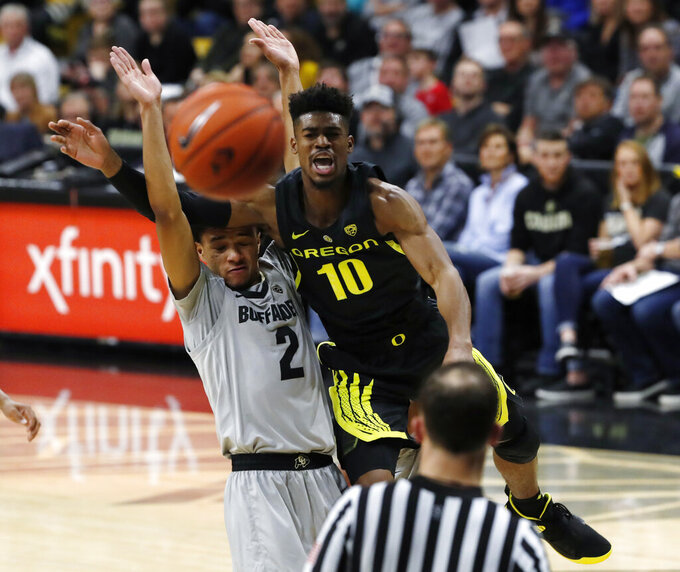 Oregon guard Victor Bailey Jr., back right, loses control of the ball as he is called for a foul while driving the lane past Colorado guard Daylen Kountz in the first half of an NCAA college basketball game Saturday, Feb. 2, 2019, in Boulder, Colo. (AP Photo/David Zalubowski)