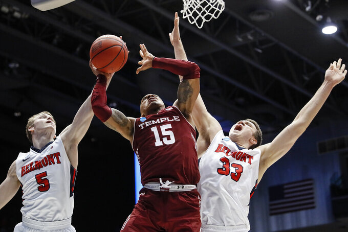 Belmont's Adam Kunkel (5) blocks a shot by Temple's Nate Pierre-Louis (15) during the second half of a First Four game of the NCAA college basketball tournament, Tuesday, March 19, 2019, in Dayton, Ohio. (AP Photo/John Minchillo)