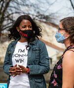 """Mayoral candidate Tishaura Jones talks to voter Jennifer Reyes outside the polling place at Hodgen Tech Academy in St. Louis on Tuesday, April 6, 2021. """"I came out to vote for Tishaura,"""" said Reyes. """"I supported her in the last election and I'm so happy to do it again.""""  (Sara Diggins/St. Louis Post-Dispatch via AP)"""