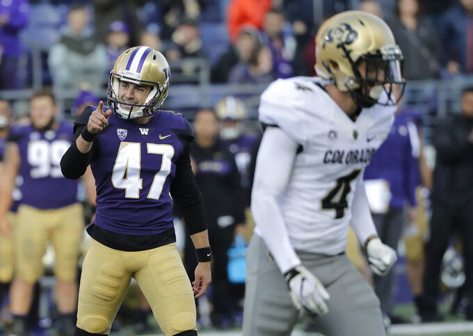 Washington kicker Peyton Henry (47) reacts after he kicked a field goal in the second half of an NCAA college football game against Colorado, Saturday, Oct. 20, 2018, in Seattle. Washington won 27-13. (AP Photo/Ted S. Warren)