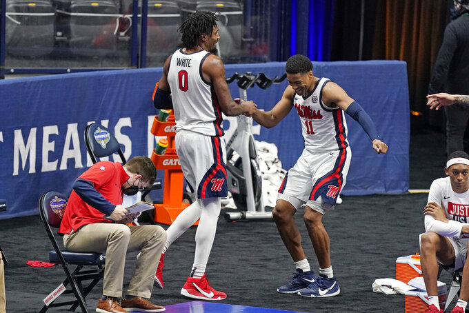 Mississippi's Romello White (0) and Matthew Murrell (11) celebrate in the final seconds of a win over South Carolina in an NCAA college basketball game in the Southeastern Conference Tournament Thursday, March 11, 2021, in Nashville, Tenn. (AP Photo/Mark Humphrey)