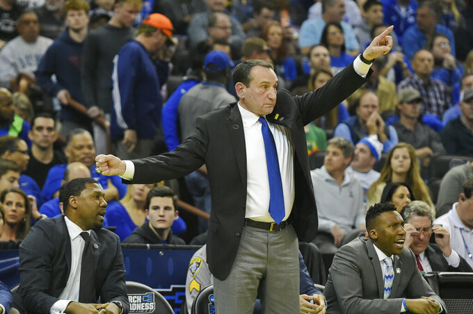 Duke head coach Mike Krzyzewski gestures during a first round men's college basketball game against North Dakota State in the NCAA Tournament in Columbia, S.C. Friday, March 22, 2019. (AP Photo/Richard Shiro)