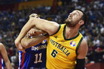 Andrew Bogut of Australia battles for a rebound with Eloy Vargas of the Dominican Republic during their second round basketball game in the FIBA Basketball World Cup in Nanjing in eastern China's Jiangsu province, Saturday, Sept. 7, 2019. (AP Photo)