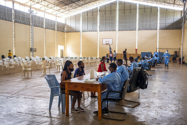 Nurses collect the data of people about to get tested for COVID-19 at a testing center in the capital Kigali, Rwanda, Tuesday, July 28, 2020. Like many countries, Rwanda is finding it impossible to test each of its citizens for the coronavirus amid shortages of supplies but researchers there have created an innovative approach using an algorithm to refine the process of pooled testing that's drawing attention beyond the African continent. (AP Photo)