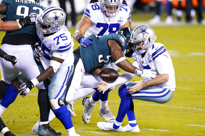 Dallas Cowboys' Ben DiNucci (7) fumbles as he is hit by Philadelphia Eagles' Brandon Graham (55) during the first half of an NFL football game, Sunday, Nov. 1, 2020, in Philadelphia. (AP Photo/Chris Szagola)