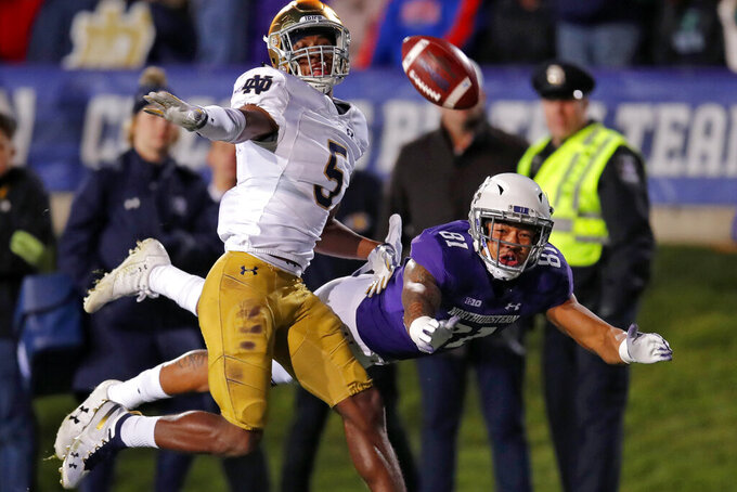 In this Nov. 3, 2018, file photo, Notre Dame cornerback Troy Pride Jr., left, defends as Northwestern's Ramaud Chiaokhiao-Bowman, right, cannot make the catch during the first half of an NCAA college football game in Evanston, Ill. The Carolina Panthers selected Pride in the fourth round of the NFL football draft on Saturday, April 25, 2020. (AP Photo/Jim Young, File)