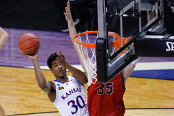 Kansas guard Ochai Agbaji (30) shoots over Eastern Washington forward Tanner Groves (35) during the first half of a college basketball game in the first round of the NCAA tournament at Farmers Coliseum in Indianapolis, Ind., Saturday, March 20, 2021. (AP Photo/AJ Mast)