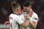 England's Kalvin Phillips, left, and Declan Rice celebrate their side's 2-1 win at the end of the Euro 2020 soccer championship semifinal match between England and Denmark at Wembley stadium in London, Wednesday, July 7, 2021. (AP Photo/Carl Recine, Pool)