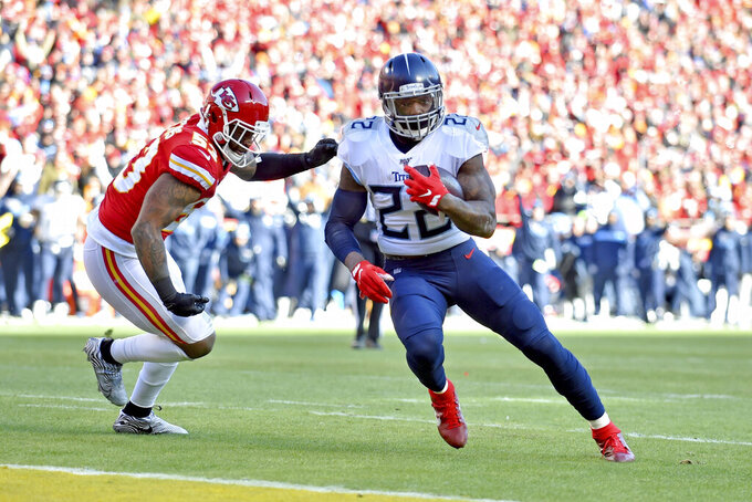 FILE - In this Jan. 19, 2020, file photo, Tennessee Titans' Derrick Henry (22) runs for a touchdown past Kansas City Chiefs linebacker Anthony Hitchens (53) during the NFL AFC Championship football game in Kansas City. Derrick Henry signed his franchise tag for 2020, as the Titans will return nine offensive starters from 2019. (AP Photo/Ed Zurga, File)