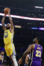 Golden State Warriors' Willie Cauley-Stein (2) dunks past Los Angeles Lakers' LeBron James (23) during the first half of an NBA basketball game Wednesday, Nov. 13, 2019, in Los Angeles. (AP Photo/Marcio Jose Sanchez)