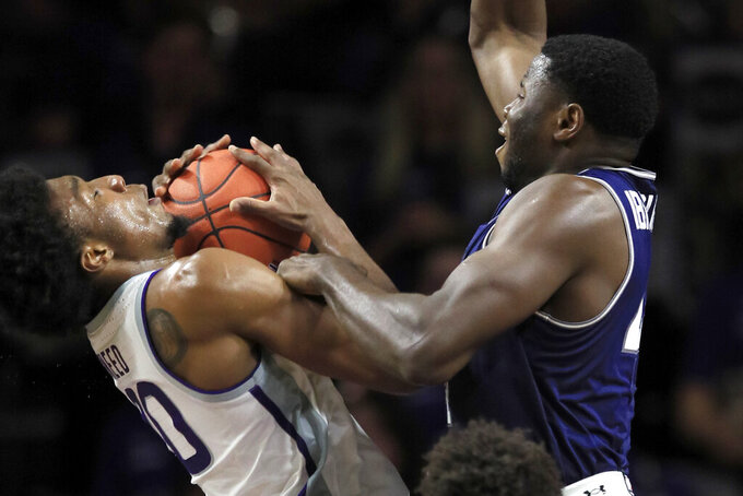 Kansas State forward Xavier Sneed, left, is fouled by Monmouth center Sam Ibiezugbe during the first half of an NCAA college basketball game in Manhattan, Kan., Wednesday, Nov. 13, 2019. (AP Photo/Orlin Wagner)