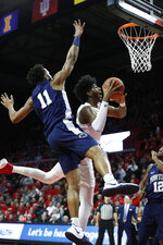 Rutgers center Myles Johnson shoots next to Penn State forward Lamar Stevens (11) during the first half of an NCAA college basketball game Tuesday, Jan. 7, 2020, in Piscataway, N.J. (AP Photo/Michael Owens)