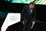 Brazilian President Jair Bolsonaro greets participants after his speech during at the Future Investment Initiative forum in Riyadh, Saudi Arabia, Wednesday, Oct. 30, 2019. Brazil's president has launched a fiery defense of his far-right government while on a visit to Saudi Arabia, blasting any criticism of his policies on recent fires in the Amazon region. (AP Photo/Amr Nabil)