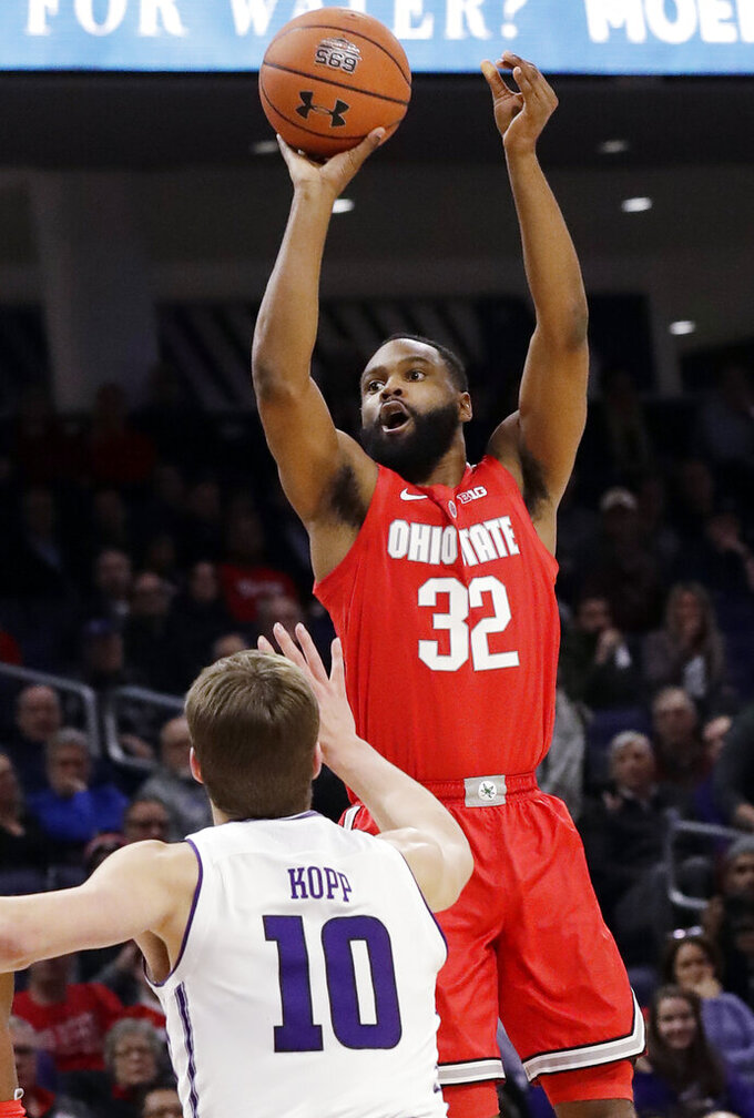 Ohio State guard Keyshawn Woods shoots over Northwestern forward Miller Kopp during the first half of an NCAA college basketball game Wednesday, March 6, 2019, in Evanston, Ill. (AP Photo/Nam Y. Huh)
