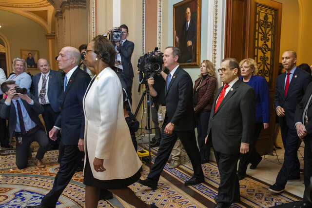 Impeachment managers, House Judiciary Committee Chairman, Rep. Jerrold Nadler, D-N.Y., and House Intelligence Committee Chairman Adam Schiff, D-Calif., together with House Sergeant at Arms Paul Irving and Clerk of the House Cheryl Johnson leave the Senate after delivering the articles of impeachment against President Donald Trump to Secretary of the Senate Julie Adams on Capitol Hill in Washington, Wednesday, Jan. 15, 2020. Others are Rep. Hakeem Jeffries, D-N.Y., Rep. Zoe Lofgren, D-Calif. (AP Photo/Manuel Balce Ceneta)