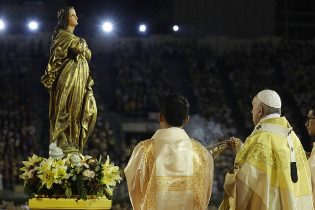 FILE - In this Nov. 21, 2019 file photo, Pope Francis blesses a statue of the Mother Mary as he celebrates Mass at the National Stadium, in Bangkok, Thailand. Pope Francis is giving his blessing to a new Vatican think tank that is seeking to prevent the Mafia and organized crime groups from exploiting the image of the Virgin Mary for their own illicit ends. (AP Photo/Gregorio Borgia)