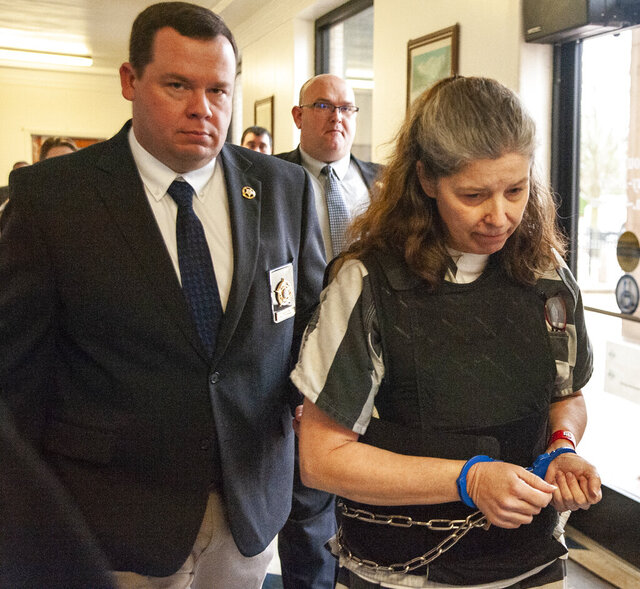 Rebecca O'Donnell, right, is escorted down a hallway by Randolph County Sheriff Kevin Bell after a hearing on Wednesday, Jan. 29, 2020, at the Randolph County Courthouse in Pocahontas, Ark. O'Donnell has been accused of the murder of former Arkansas state Sen. Linda Collins. (Alex Gladden/The Jonesboro Sun via AP)