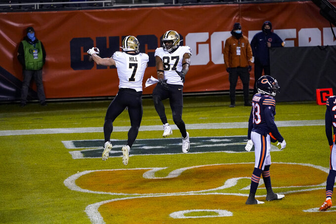 New Orleans Saints quarterback Taysom Hill (7) celebrates a touchdown with tight end Jared Cook (87) against the Chicago Bears in the second half of an NFL football game in Chicago, Sunday, Nov. 1, 2020. (AP Photo/Charles Rex Arbogast)