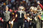 Minnesota running back Rodney Smith, center, celebrates with head coach P.J. Fleck, left, and teammate Mohamed Ibrahim, right, after scoring a touchdown against Maryland during an NCAA college football game Saturday, Oct. 26, 2019, in Minneapolis. (AP Photo/Stacy Bengs)