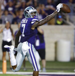 Kansas State wide receiver Isaiah Zuber (7) runs the ball 85 yards on a punt return for a touchdown during the second half of an NCAA college football game against South Dakota Saturday, Sept. 1, 2018, in Manhattan, Kan. Kansas State won 27-24. (AP Photo/Charlie Riedel)