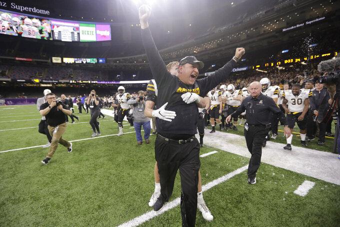 Appalachian State coach Shawn Clark celebrates the team's win in the New Orleans Bowl NCAA college football game against UAB in New Orleans, Saturday, Dec. 21, 2019. Appalachian State won 31-17. (AP Photo/Brett Duke)