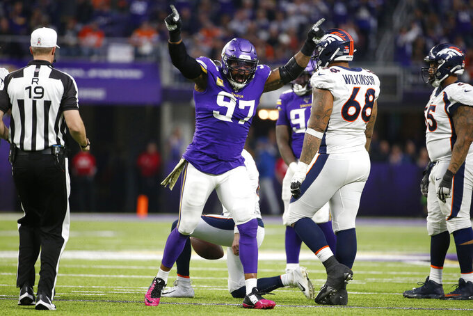 Minnesota Vikings defensive end Everson Griffen celebrates after sacking Denver Broncos quarterback Brandon Allen, rear, during the second half of an NFL football game, Sunday, Nov. 17, 2019, in Minneapolis. (AP Photo/Bruce Kluckhohn)