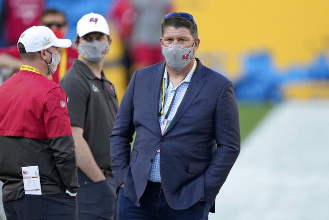Tampa Bay Buccaneers general manager Jason Licht stands on the field before the NFL Super Bowl 55 football game between the Kansas City Chiefs and Buccaneers, Sunday, Feb. 7, 2021, in Tampa, Fla. (AP Photo/Chris O'Meara)