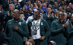 Former players on Michigan State's 1979 national championship team, including Magic Johnson, center, Jay Vincent, left, and Greg Kelser, right, react during the first half of an NCAA college basketball game against Minnesota, Saturday, Feb. 9, 2019, in East Lansing, Mich. (AP Photo/Al Goldis)