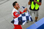 Kyle Larson takes the checkered flag after winning a NASCAR Cup Series auto race Sunday, June 20, 2021, in Lebanon, Tenn. (AP Photo/John Amis)