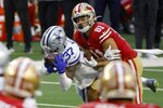 Dallas Cowboys safety Donovan Wilson (37) intercepts a pass intended for San Francisco 49ers tight end Jordan Reed (81) in the second half of an NFL football game in Arlington, Texas, Sunday, Dec. 20, 2020. (AP Photo/Ron Jenkins)