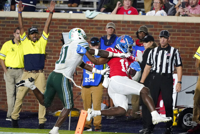 Mississippi wide receiver Dontario Drummond (11) beats Tulane safety Larry Brooks (31) for a touchdown run during the first half of an NCAA college football game, Saturday, Sept. 18, 2021, in Oxford, Miss. (AP Photo/Rogelio V. Solis)