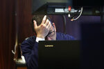Trader David Fox works on the floor of the New York Stock Exchange, Monday, Aug. 12, 2019. Stocks are extending their losses at midday as investors opened the week heading for safety amid heightened anxiety over the U.S.-China trade war. (AP Photo/Richard Drew)
