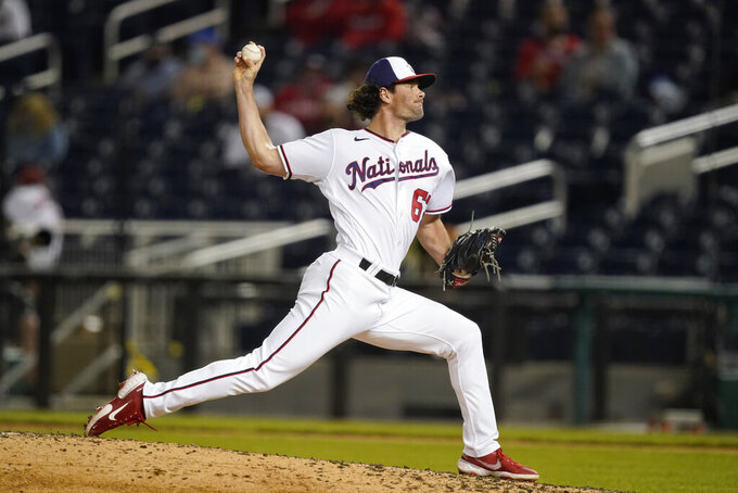Washington Nationals pitcher Kyle Finnegan throws during the sixth inning of the team's baseball game against the Atlanta Braves at Nationals Park, Wednesday, May 5, 2021, in Washington. (AP Photo/Alex Brandon)