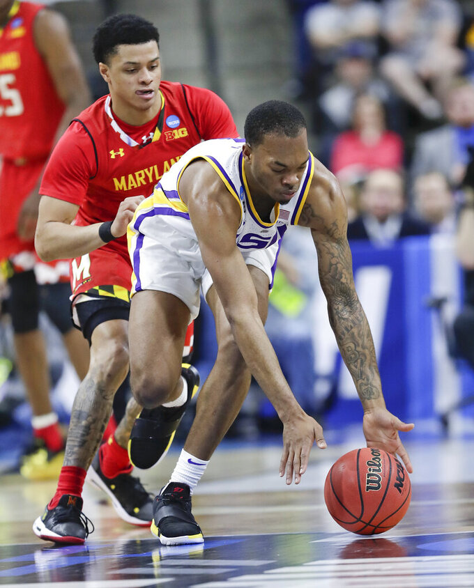 LSU's Javonte Smart, front, goes after a loose ball past Maryland's Anthony Cowan Jr. during the first half of a second-round game in the NCAA men's college basketball tournament in Jacksonville, Fla., Saturday, March 23, 2019. (AP Photo/John Raoux)