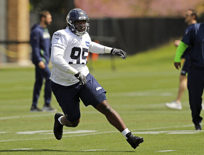 Seattle Seahawks defensive end L.J. Collier runs a drill during NFL football rookie minicamp Friday, May 3, 2019, in Renton, Wash. (AP Photo/Ted S. Warren)