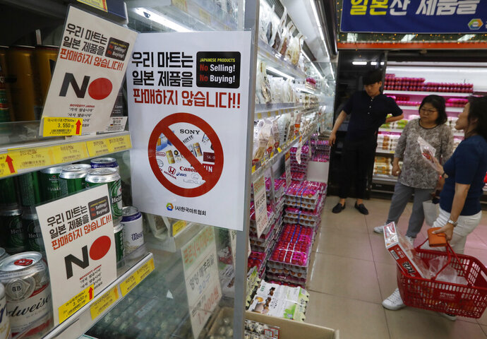 FILE - In this Tuesday, July 9, 2019, file photo, notices campaigning for a boycott of Japanese-made products are displayed at a store in Seoul, South Korea. South Koreans believe Japan still hasn't fully acknowledged responsibility for atrocities committed during its 1910-45 colonial occupation of Korea. Thousands of South Koreans have signed petitions posted on the presidential office's website that call for boycotting Japanese products and travel to Japan. The signs read: