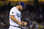 Los Angeles Dodgers starting pitcher Clayton Kershaw looks down after giving up a solo home run to Colorado Rockies' Garrett Hampson during the fourth inning of a baseball game Friday, Sept. 20, 2019, in Los Angeles. (AP Photo/Mark J. Terrill)