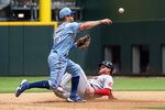 Texas Rangers second baseman Nick Solak (15) forces out Boston Red Sox's Alex Verdugo as he turns a double play during the fifth inning of a baseball game Sunday, May 2, 2021, in Arlington, Texas. (AP Photo/Jeffrey McWhorter)