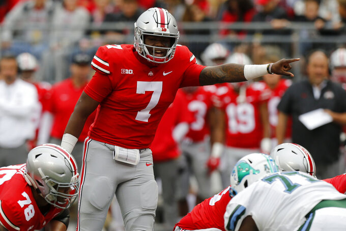 FILE - In this Saturday, Sept. 22, 2018 file photo, Ohio State quarterback Dwayne Haskins plays against Tulane during an NCAA college football game in Columbus, Ohio. No. 3 Ohio State is looking to get more out of its ground game as Minnesota visits. Quarterback Dwayne Haskins has piled up a nation-leading 25 touchdown passes, but the Buckeyes averaged just 3.2 yards per carry against Indiana last week. Injury-riddled Minnesota will try to rebound after dropping its first two Big Ten games. (AP Photo/Jay LaPrete, File)
