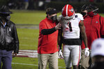 Georgia coach Kirby Smart talks with wide receiver George Pickens (1) during halftime of the team's NCAA college football game against South Carolina on Saturday, Nov. 28, 2020, in Columbia, S.C. (AP Photo/Sean Rayford)