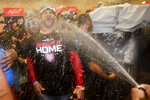 Washington Nationals manager Dave Martinez celebrates in the locker room after the Nationals' 7-3 win in 10 innings against the Los Angeles Dodgers in Game 5 of a baseball National League Division Series on Wednesday, Oct. 9, 2019, in Los Angeles. (AP Photo/Marcio Jose Sanchez)