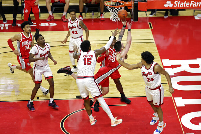 Rutgers guard Aiden Terry (25) drives to the basket past Rutgers center Myles Johnson (15) during the second half of an NCAA college basketball game Saturday, Jan. 9, 2021, in Piscataway, N.J. Ohio State won 79-68. (AP Photo/Adam Hunger)