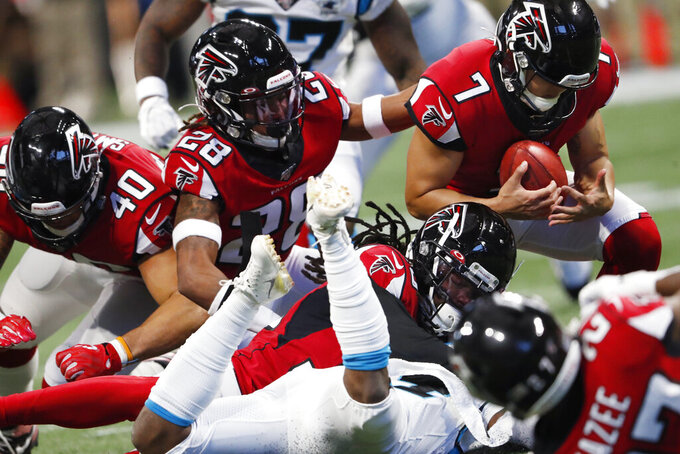 Atlanta Falcons kicker Younghoe Koo (7) recovered his kick off aftyer the Carolina Panthers fumbled on the return during the second half of an NFL football game, Sunday, Dec. 8, 2019, in Atlanta. (AP Photo/John Bazemore)