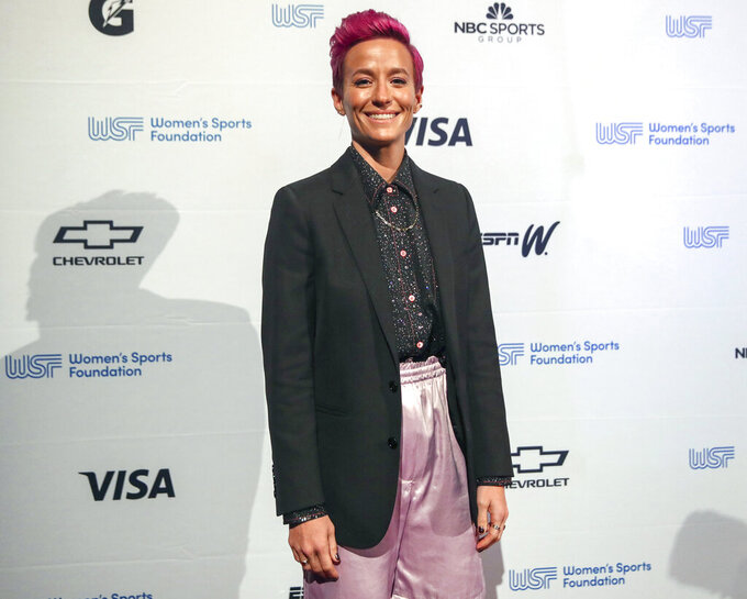 """FILE - Soccer player Megan Rapinoe poses for photos on the red carpet of the Women's Sports Foundation's 40th annual Salute to Women in Sports in New York on Oct. 16, 2019. Rapinoe has selected #MeToo founder Tarana Burke's memoir, """"Unbound,"""" for her new book club. (AP Photo/Mary Altaffer, File)"""